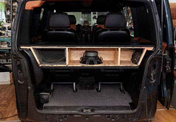 infinite baffle free air subwoofer mounted in van